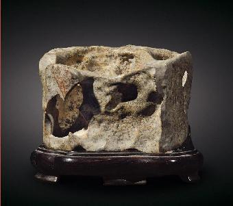 是纯天然形成的化石有的甚至可以用奇石赏石来形容