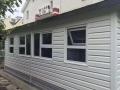 包头市外墙装饰板PVC外墙挂板仿木纹扣板学校幼儿园